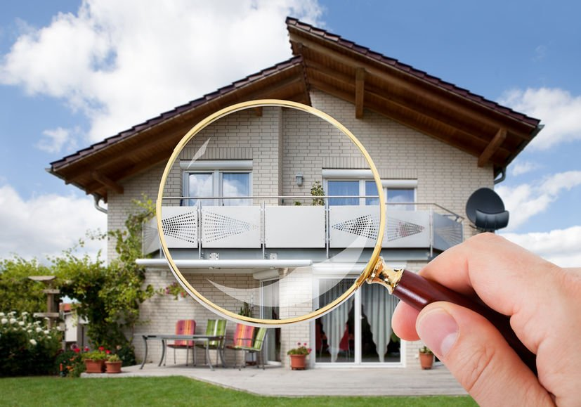 Scent Marketing Solutions. Magnifying glass being held over a house as if to say let's take a closer look.